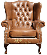 Chesterfield Highclere High Back Wing Chair UK Manufactured Old English Tan Leather With Matching Footstool Brass Studs